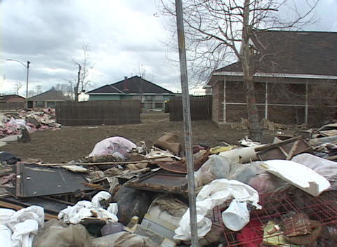 Garbage and refuse is scattered around a neighborhood following Hurricane Katrina Footage