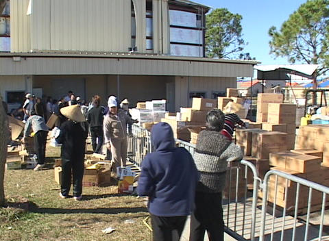 People distribute and collect supplies following... Stock Video Footage