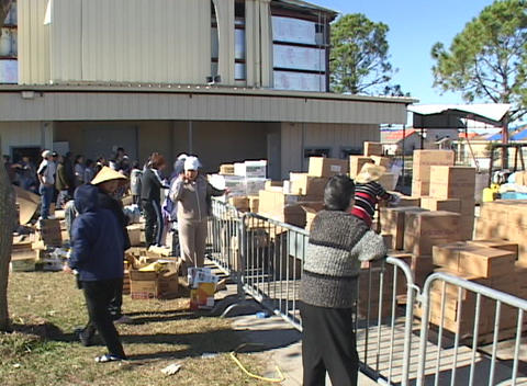 People distribute and collect supplies following Hurricane Katrina Footage