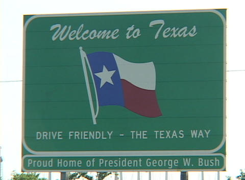 A sign welcomes visitors to Texas, home of George W. Bush Footage
