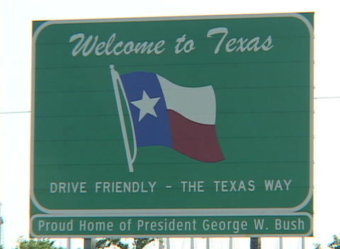 A sign welcomes visitors to Texas, home of George W. Bush Stock Video Footage