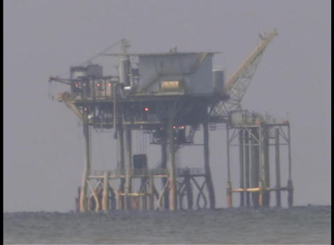 An oil platform in the Gulf of Mexico is under repair after Hurricane Katrina Footage