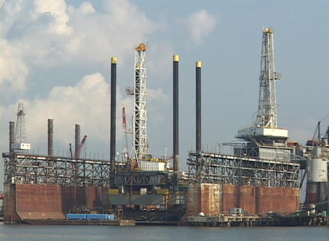 Damaged docks and oil platforms wait for repair following... Stock Video Footage