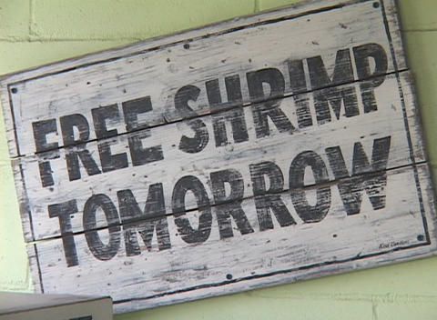A sign reads Free Shrimp Tomorrow Live Action