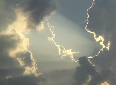 Sunlight shines through a break in the clouds Stock Video Footage