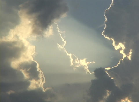 Sunlight shines through a break in the clouds Footage