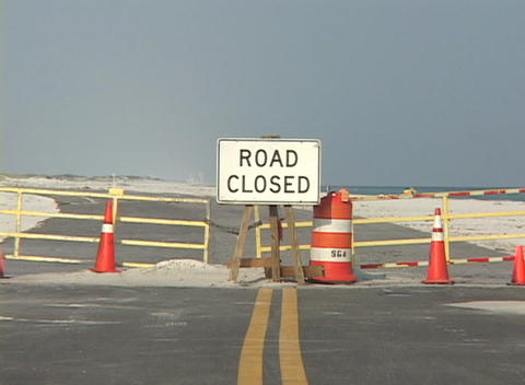 "A Road Closed"" sign sits in the middle of a highway."" Footage"