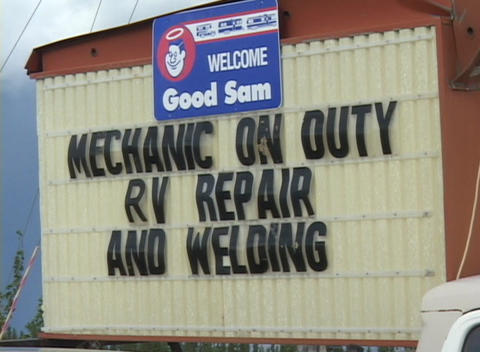 A sign says Mechanic On Duty Footage