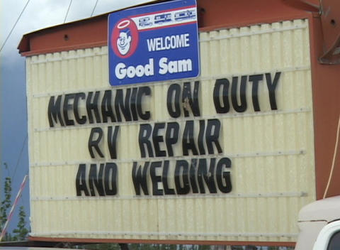 A sign says Mechanic On Duty Stock Video Footage