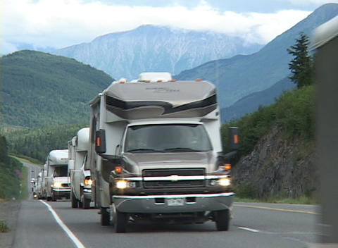 Motor homes move down a road Footage