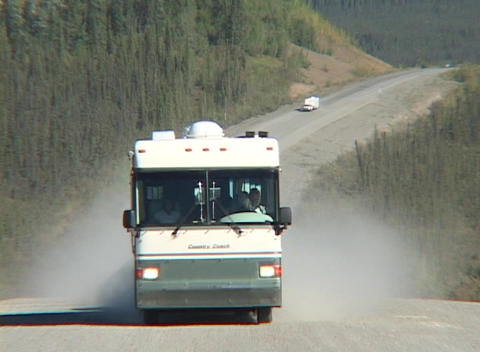 A motor home travels down a dirt road in Alaska Stock Video Footage