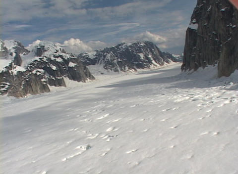 Aerial POV shot flying over an Alaskan glacier field Stock Video Footage