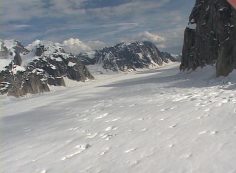 Aerial POV shot flying over an Alaskan glacier field Stock Video Footage
