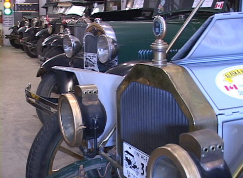 Old Model T cars are displayed in a museum Footage