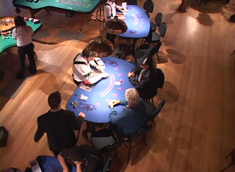 A dealer deals cards in a casino as seen from above Stock Video Footage