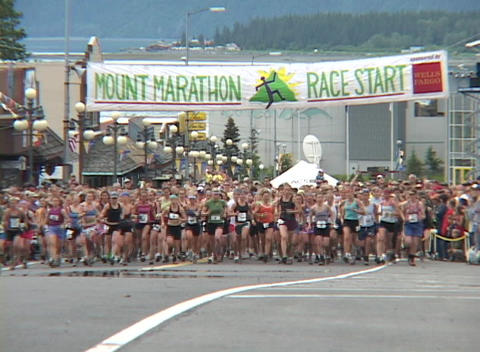 Runners leave the starting line in a marathon and running... Stock Video Footage