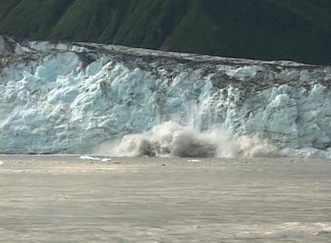 A glacier calves into the ocean Footage