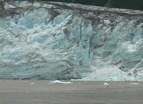 A glacier calves into the ocean Stock Video Footage