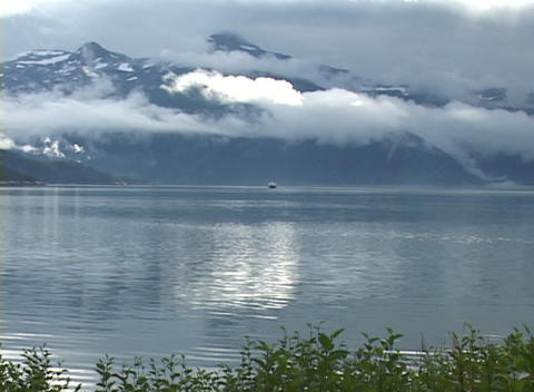 A distant cruise ship on a beautiful Alaskan fjord Stock Video Footage