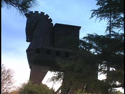 The silhouetted Trojan Horse rises above Ancient Troy in... Stock Video Footage