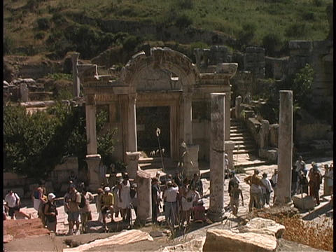 Tourists visit the Temple of Hadrian in Ephesus, Turkey Stock Video Footage