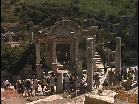 Tourists visit the Temple of Hadrian in Ephesus, Turkey Footage