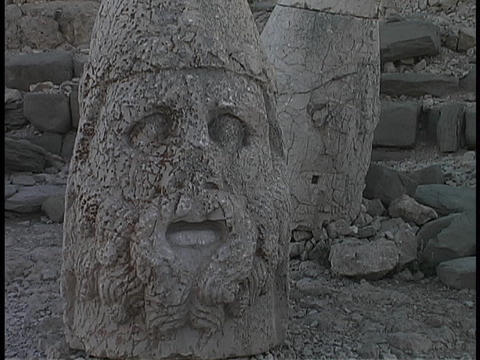 The broken head of Antiochus lies at Mount Nemrut in Turkey Stock Video Footage