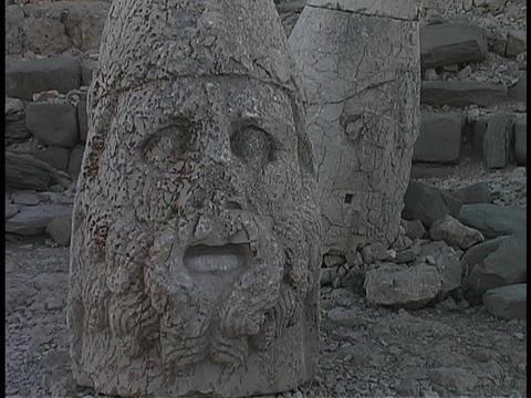 The broken head of Antiochus lies at Mount Nemrut in Turkey Stock Video Footage