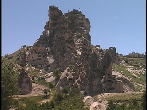 Fairy-chimney rock formations adorn a hill at Cappadocia, Turkey Footage