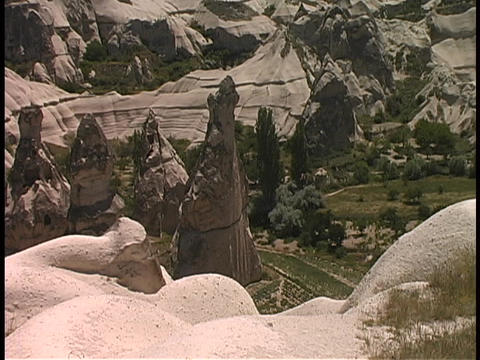 Fairy-chimney rock formations adorn the hills in... Stock Video Footage