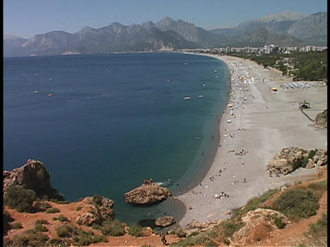 Tourists enjoy the beach at the Antalya coastline in Turkey Stock Video Footage