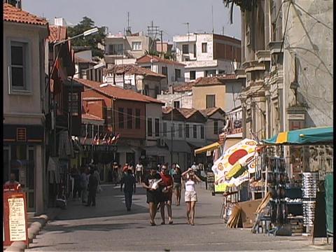 Tourists walk through an outdoor market in Turkey Stock Video Footage