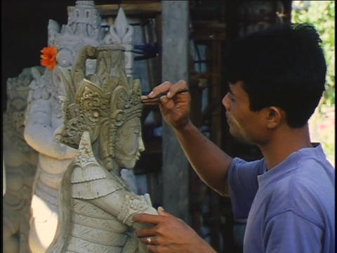 A man skillfully carves a statue Stock Video Footage
