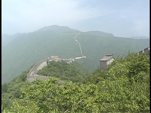 The Great Wall follows the rolling mountains in China Stock Video Footage