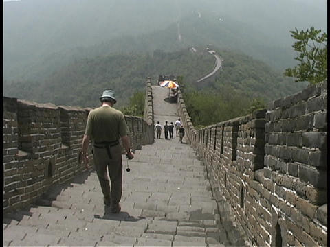 Tourist hike down stairs on the Great Wall of China Stock Video Footage