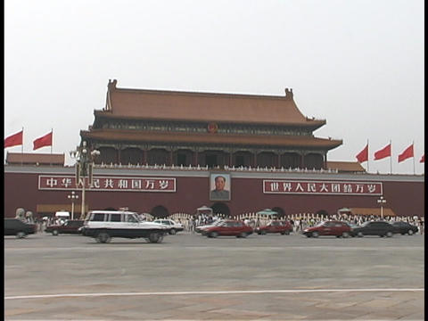 Traffic drives through Tiananmen Square near The Great Hall Footage