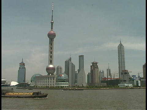 A Pearl TV tower rises above the Huangpu River in Shanghai Stock Video Footage