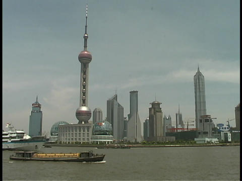 A Pearl TV tower rises above the Huangpu River in Shanghai Footage