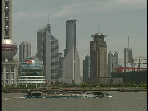 A boat travels on the Huangpu River in Shanghai Stock Video Footage