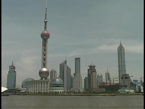 A Pearl TV Tower stands along the Huangpu River in Shanghai Stock Video Footage