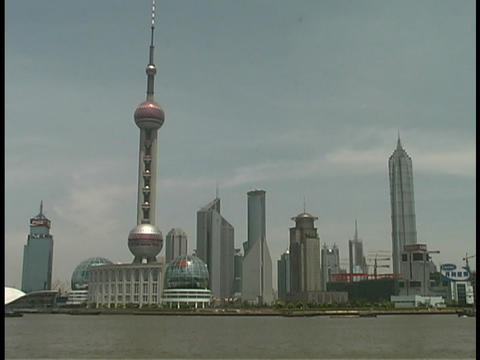 A Pearl TV Tower stands along the Huangpu River in Shanghai Footage