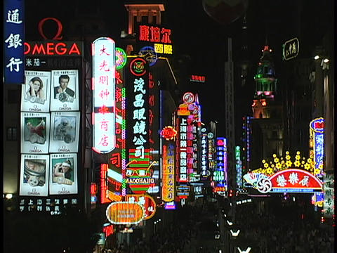 Colorful neon signs light up a shopping district of Shanghai at night Live Action