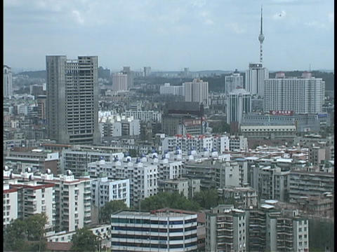 High-rise buildings tower over downtown Wuhan, China Live Action