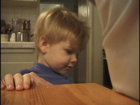 A parent combs a little boy's hair Stock Video Footage