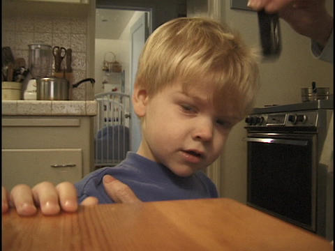 A parent combs a little boy's hair Stock Video Footage