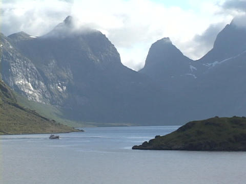 A boat crosses a fjord in Norway Stock Video Footage