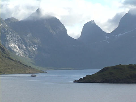 A boat crosses a fjord in Norway Footage
