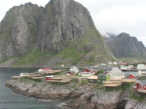 A small fishing village nestles on the edge of a fjord in Norway Footage