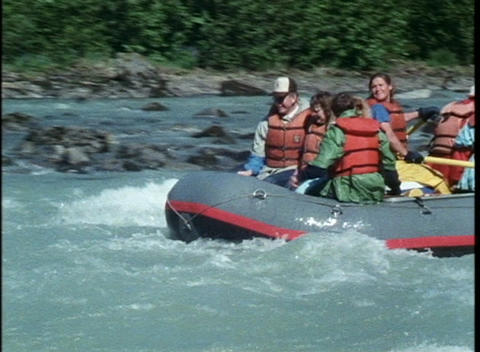 A group of rafters navigate down a river Stock Video Footage