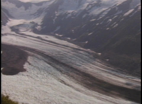 A river flows through an ice covered valley Stock Video Footage
